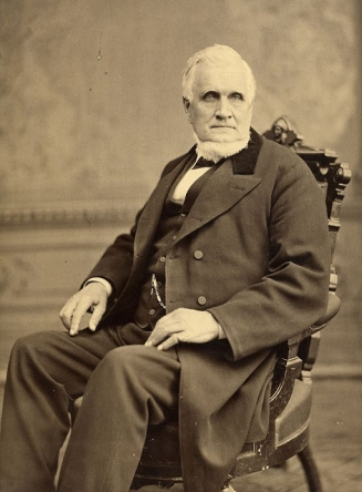 John_Taylor_seated_in_chair (471x640)